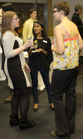 Anna Roberts, left, talks to fellow Elia Scholars Syeda Mariam Humayun centre and Melanie Wilmink, right at a reception celebrating the Elia Scholars