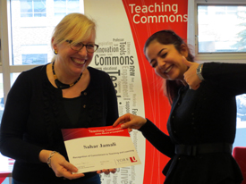 Teaching Commons Director Celia Popovic, left, presents Sahar Jamali with her Record of Completion