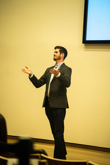 photo of Joshua Mugg giving his presentation at the Ontario 3MT Final