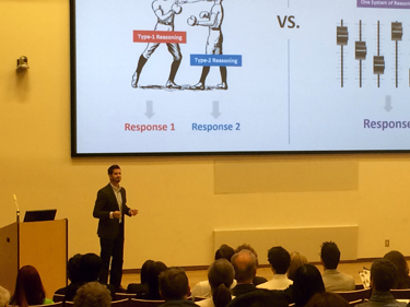 photo of York PhD student Joshua Mugg presenting his thesis at the Ontario 3MT final