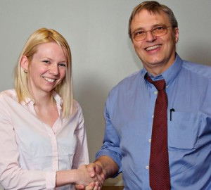 photo of student Lesley Deas being congratulated by professor Laurence Harris