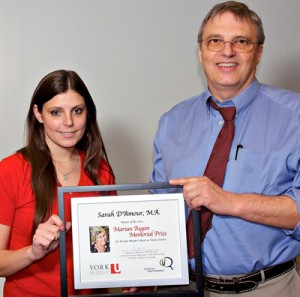 photo of student Sarah D'Amour being congratulated by  professor Laurence Harris