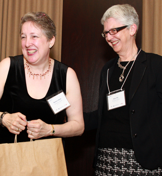 photo of Conference co-organizers Barb Wells, executive assistant to the associate vice-president Graduate at York University, with Alice Pitt, Vice-Provost Academic, share a lighter moment during the awards presentation ceremony