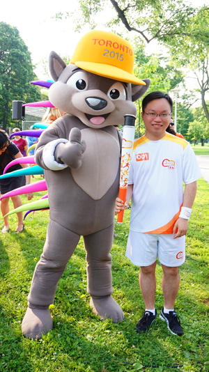 York PhD student Chris Chen with Pachi the Pan Am Games mascot