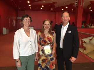 photo of Theatre Department Chair Elizabeth Asselstine (left) and AMPD Dean Shawn Brixey (right) stand with Professor Laura Levin, recipient of the 2015 School of the Arts, Media, Performance & Design Senior Teaching Award