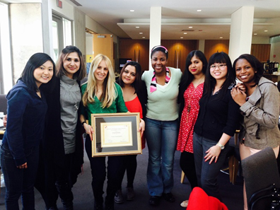 photo of Vivian after receiving the 2013 John O'Neil Award for Teaching Excellence from members of the Sociology Undergraduate Student's Association (S.U.S.A)