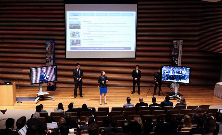 photo of a group of people making presentation on stage