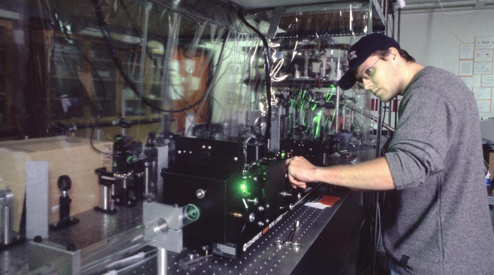 photo of Graduate Student Matthew Weel aligning Titanium:Sapphire Ring Laser
