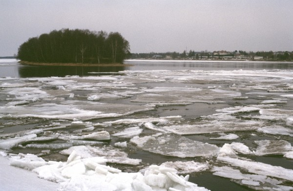 photo of river with melting ice