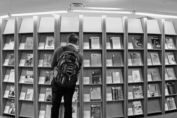 student in bronfman library