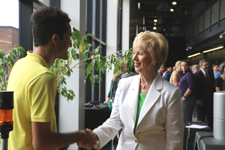photo of MP Judy Sgro speaking with a student researcher about a VISTA project