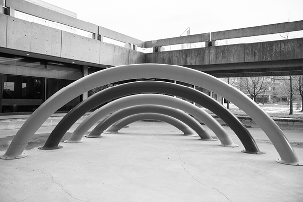 black and white photo of a rainbow sculpture outside the Ross building