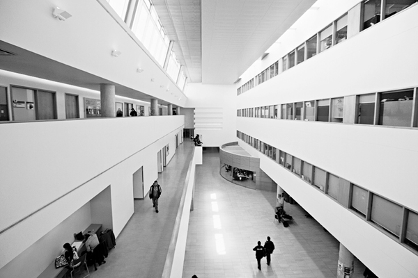 black and white photo of the inside of a multi-floor atrium
