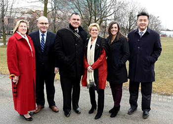 group photo of Minister Helena Jaczek, Minister Steven Del Duca, York PhD student Jesse Thistle, Premier Kathleen Wynne, York PhD student Dessi Zaharieva and MPP Han Dong