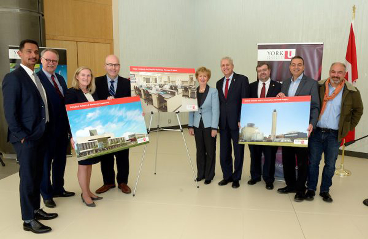 photo of people unveiling images to complement an infrastructure funding announcement