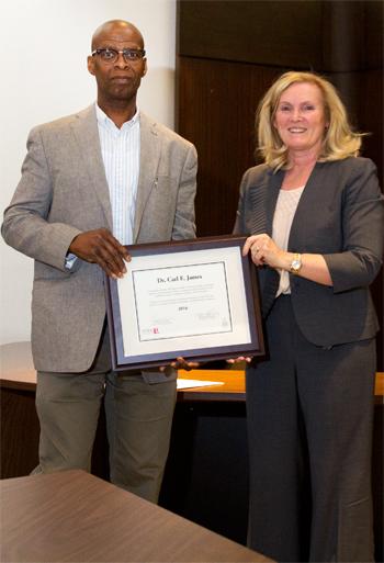 photo of professor Carl James and vice-president academic and provost Rhonda Lenton