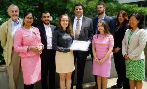 photo of a group of people in honour of an inaugural scholarship recipient