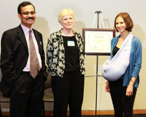 photo of FGS Dean Fahim Quadir, left, Prof. Pat Armstrong and nominator Rachel Barken (with son Francis)