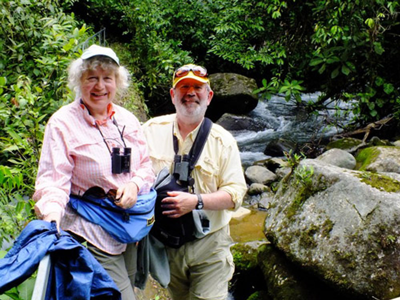 photo of Don Downer and Adrienne Perry at Penas Blancas River, the site of the old log bridge