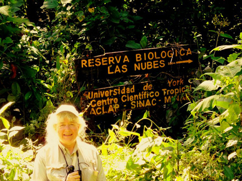 photo of Adrienne Perry preparing to head on to the trail that leads to Las Nubes