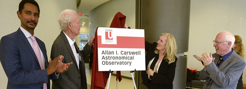photo of Faculty of Science Dean Ray Jayawardhana with York U Professor Emeritus Allan Carswell, President and Vice-Chancellor Rhonda Lenton and Univeristy Professor Paul Delaney unveil the sign in Allan Carswell's honour for the new Allan I. Carswell Astronomical Observatory