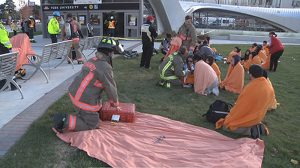 photo of emergency responders treating simulated victims in front of the subway station