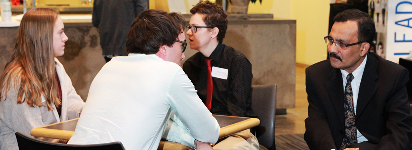 photo of Dean Quadir talking to a student at the scholars reception