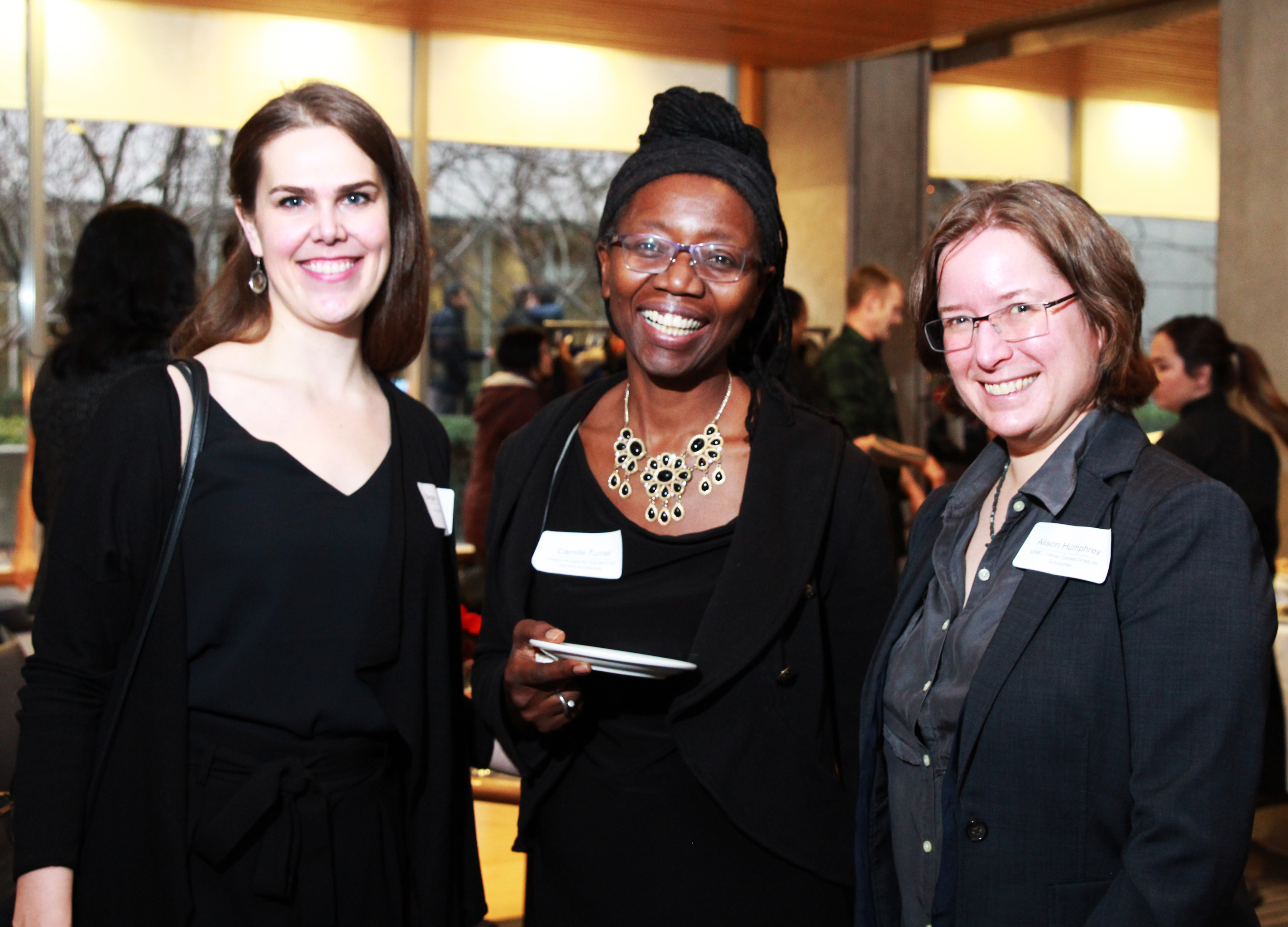 photo of three women who were attending the scholar's reception as students