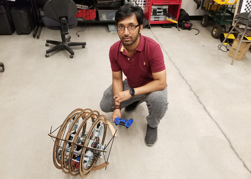 photo of Bir Bikram Day with his spherical robot