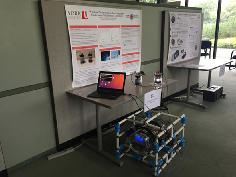 photo of the students' posters at the conference and Robert Codd–Downey's LightByte technology