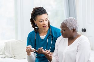 photo of a female nurse talking to a female patient