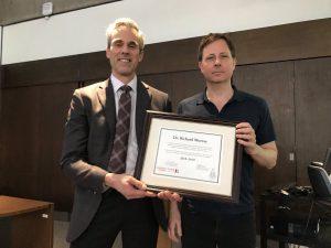 photo of Dean Thomas Loebel and Professor Richard Murray with the teaching award