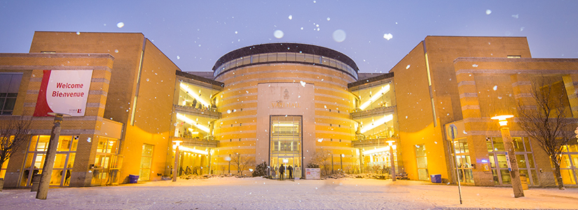 photo of Vari Hall with falling snow