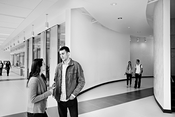 photo of students talking in a hallway