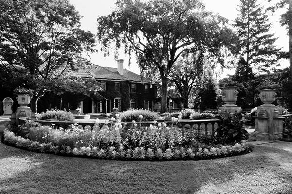 photo of Glendon Hall with the flowers in bloom
